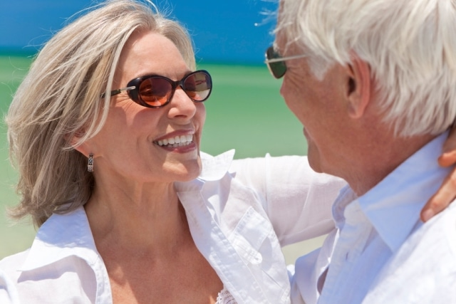 Baby Boomer Couple Dancing Holding Hands on A Tropical Beach