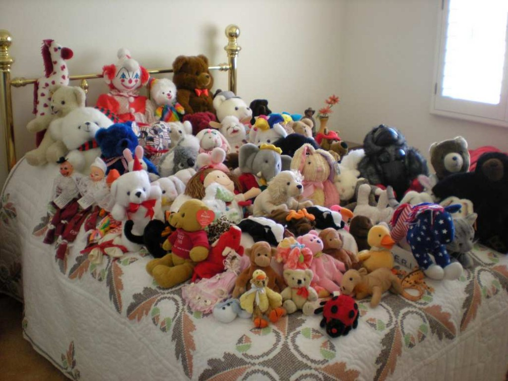 stuffed animals on bed