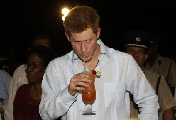 Britain's Prince Harry drinks a hibiscus rum punch at a street party in Belmopan, Belize